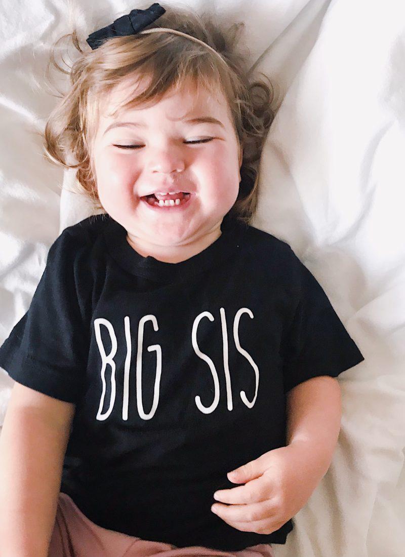 Girl Laughing wearing Big Sis Shirt